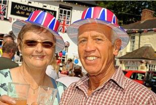 Fran Ridgway, left, and Gordon Gridley raise a glass to the Queen at the Angarrack jubilee party.